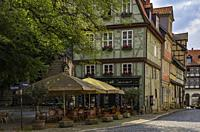 Street cafe at the Kornmarkt in the Old Town of Quedlinburg, Saxony-Anhalt, Germany.