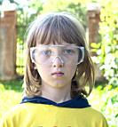 Portrait of a Boy in Protective Glasses Outdoors.