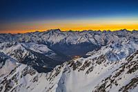 Sunset and view from Pic du Midi de Bigorre. On the left Vignemale mountain. On the right Balaitus mountain or Pic du Balaitous. Grand Tourmalet ski a...