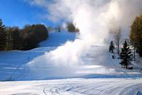 Snow making machines billow new snow onto the ski slopes in Vermont.