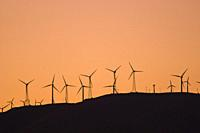 Wind turbines at the Tehachapi Wind Farm (2nd largest in the world) at sunset, Tehachapi Mountains, California USA.