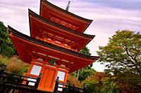 Artistic photo of Koyasu pagoda to goddess Koyasu Kannon where women come asking for safe childbirth, at Kiyomizu-dera Buddhist temple in autumn. Higa...