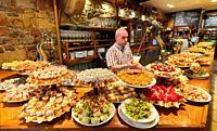 Waiter serving cider, Pintxos, Bar Taberna Aralar, Parte Vieja, Old Town, Donostia, San Sebastian, Gipuzkoa, Basque Country, Spain