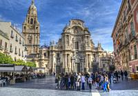 HDR image of tourists in front of Murcia Cathedral in Cathedral Square in Murcia Spain.