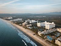 Early morning aerial view at stretch of beach with hotels at Nuevo Vallarta, Riviera Nayarit, Mexico.