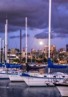 San Diego Harbor with the Moon in the background. San Diego, California, USA.