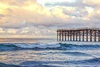 View of Crystal Pier and the Pacific Ocean on a cloudy morning. San Diego, California, USA.