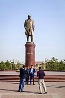 Uzbek People Pose For A Photo Under The Statue Of Islam Karimov, Samarkand, Uzbekistan.