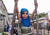Young girl dressed with a blue veil, Lamu County, Lamu Town, Kenya.