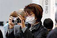 March 3, 2018, Yokohama, Japan - A woman tries out the new Lumix camera DC-GX7 MK3 at the CP+ Camera & Photo Imaging Show 2018 in Pacifico Yokohama. J...