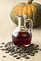 Bottle with tasty pumpkin seed oil and roasted seeds.