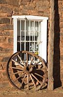 Wagonwheel by window, Hubbell Trading Post National Historic Site, Arizona.