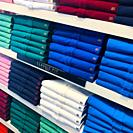 Clothing store, shirts and polos in different colors,