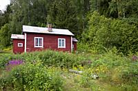 Cabins in Hardangervidda, Norway,Scandinavia. Hardangervidda is a mountain plateau in central southern Norway, covering parts of the counties of Buske...
