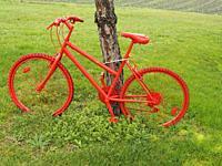 brightly coloured decorative bicycle beside former Tour de France route, Monbazillac, Dordogne Department, Aquitaine, France.