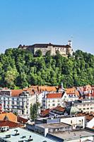 View over the old town of Ljubljana to the castle. The Ljubljana Castle is a powerful medieval fortress and the symbol of the Slovenian capital, Ljubl...