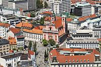 View over the old town of Ljubljana to the Franciscan church (Franciskanska cerkev) and to the bridge Tromostovje (Three Bridges). The buildings are l...