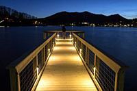 Woman standing on Meditation Pier at Lake Junaluska, North Carolina, USA.