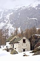Derelict house with attached barn in the mountain village of Crampiolo. Baceno Municipality. Province of Verbano-Cusio-Ossola. Piemonte. Italy.