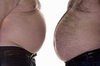 Two Overweight Men with their Bellies Isolated on White.