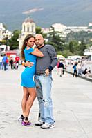 Couple of lovers having fun and taking photographs themselves with remote control on the promenade of Yalta, Crimea.