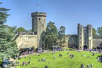 HDR image of visitors in the courtyard of Warwick Castle, Warwickshire, England.