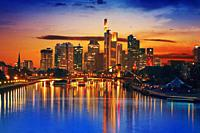 Frankfurt skyline at sunset in Germany with Meno river.