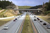 Motorway traffic on an overcast day of spring on Finnish National Road 1 in Salo, Finland