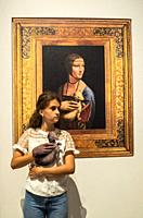 Girl in front of painting Lady with an Ermine, Narodowe Museum , National Museum, Krakow, Poland.