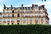 Haussmannian building facade in a sunny day. Paris, France.