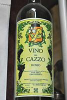Turin, Italy: ´Vino del Cazzo´ (´Fucked Wine´) bottle from the window of an antique shop specialized in old erotic goods