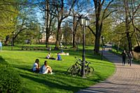 Girls sitting on the lawns in Bastion Hill park, Riga, Lativa.