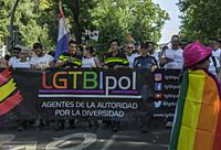 Madrid, Spain, 7 th July 2018. Gay pride parade with participants and a banner in Paseo del Prado, 7 th July 2018, Madrid.
