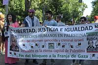 Madrid, Spain, 7 th July 2018. Gay pride parade with participants and a human rights banner in Paseo del Prado, 7 th July 2018, Madrid.