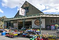 Locally-grown fruit, vegetables and flowers for sale beside the Channel Highway in Oyster Cove, southern Tasmania, Australia