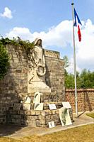 Statue, monument and French National flag in the Commonwealth War Graves Commission graveyard in Douai, Nord, Picardy, France for fallen British and C...