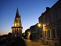 Rue sur les Murs and Tour de la Lanterne at night, La Rochelle, Charente-Maritime Department, Nouvelle Aquitaine, France.