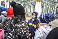 Asian tourists waiting in the entrance of the Hermitage. Winter Palace, St Petersburg, Russia.