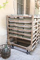 Mellow green blocks of olive Marseille soap on traditional wooden racks drying in the sun outside the Marius Fabre soap factory, Salon, Provence, Fran...