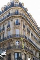 Delicate metal tracery, elegant proportions and sun washed hues of nineteenth century Belle Epoque architecture in Marseille, Provence, France.