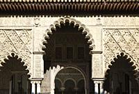 Highly artistic Moorish facade in the Patio de las Doncellas (Courtyard of the Maidens) in the Alcazar of Seville. Seville province, Andalusia, Spain.
