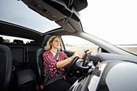 woman driving on the Alcocebre highway, Castellon, Spain