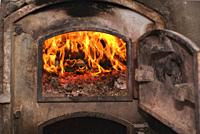 Fire wood in ancient rust stove.
