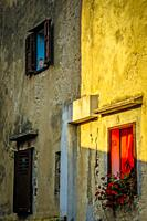 Croatian homes along narrow streets in the small fishing village of Baska on the island of Krk in the Adriatic.