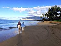 Early morning at the Charley Young Beach, S. Kihei, Maui. An elderly man and woman walk hand in hand, the perfect beginning to a nice day.