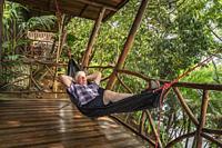 Man a Hammock, Pedacito De Ceilo Eco Lodge, San Carlos, Costa Rica.