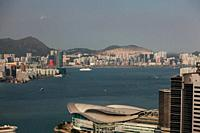Hong Kong, China - September 25, 2009: Wide view high rise towers, modern buildings and vessels on the sea in Hong Kong.