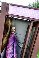 Amenia New York USA A mannequin in an old phone booth.