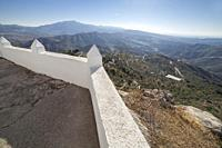 Comares cityscape. White village up on the hill of Malaga mountains, Andalusia, Spain. Panoramic view.