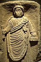Funerary stele representing a scribe ( I° or II° century AD). At Musée Sainte-Croix ( Poitiers, France).
